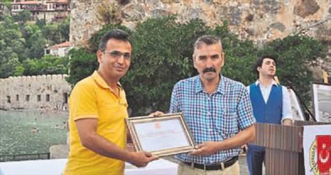 Mehmet Al'a onur plaketi