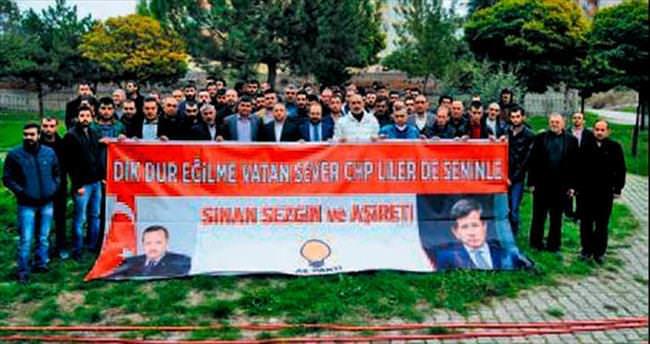 AK Parti'nin yeni üyelerinden Başbakan'a jest