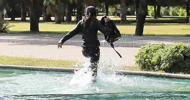 Polisten kaçmak için süs havuzuna girdi
