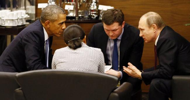 Obama ve Putin'den zirve arasında baş başa görüşme