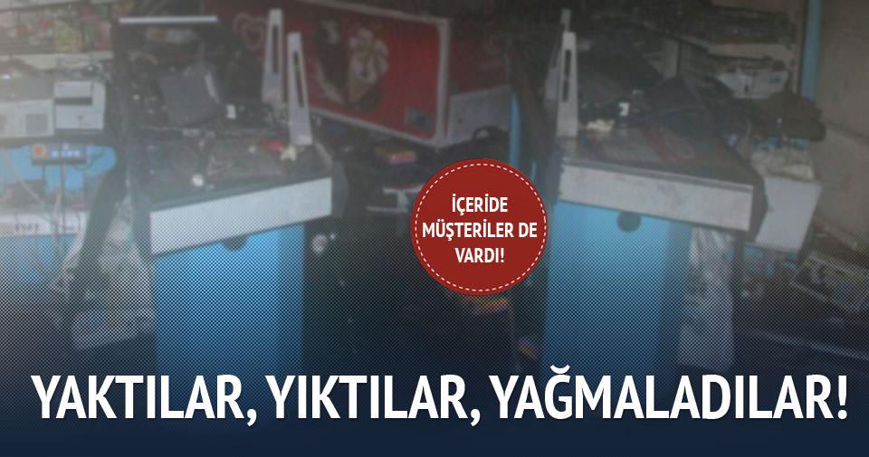 PKK yandaşları para kasalarını gasp edip, marketi ateşe verdi