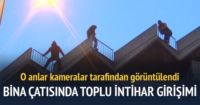 Bina çatısında toplu intihar girişimi