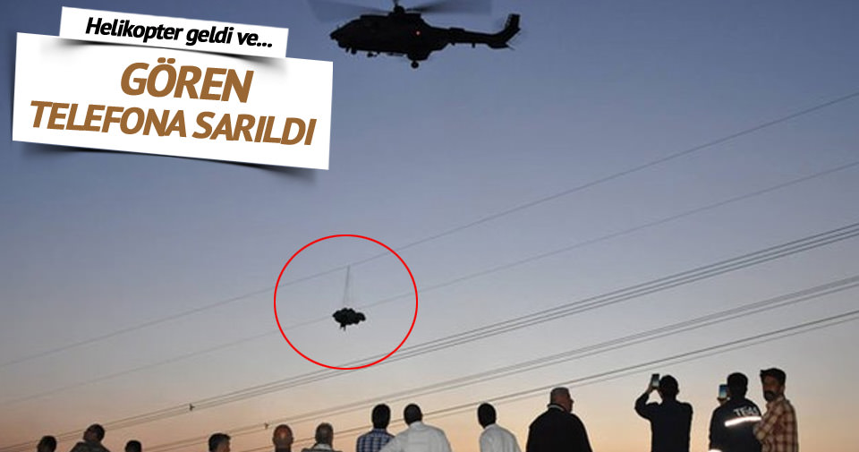 Tellere takılan paraşütçü helikopterin rüzgarıyla yere düştü