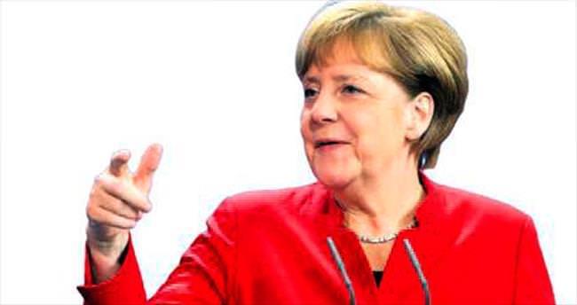 Merkel: Yaptırımların kalkması Minsk'e bağlı